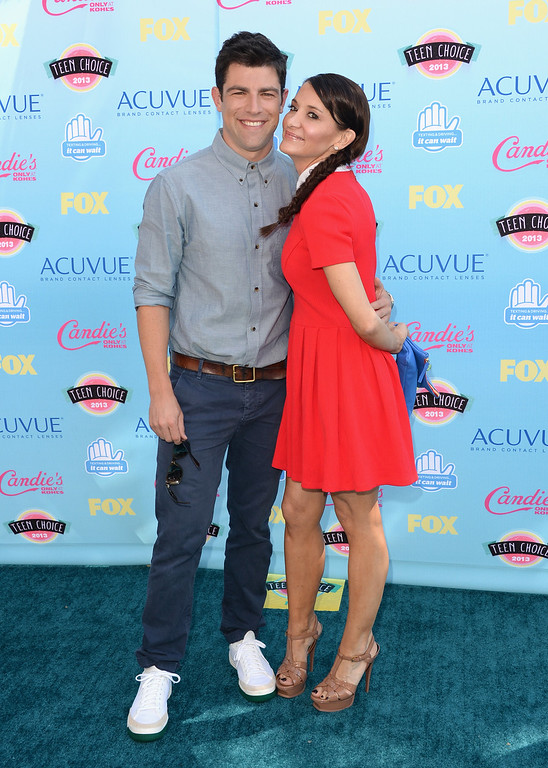 . Actor Max Greenfield (L) and wife Tess Sanchez attend the Teen Choice Awards 2013 at Gibson Amphitheatre on August 11, 2013 in Universal City, California.  (Photo by Jason Merritt/Getty Images)