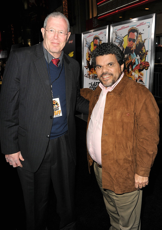 ". Michael Paseornek, Lionsgate Motion Picture Group President of Motion Picture Production and Development (L) and actor Luis Guzman arrive at the premiere of Lionsgate Films\' ""The Last Stand\"" at Grauman\'s Chinese Theatre on January 14, 2013 in Hollywood, California.  (Photo by Kevin Winter/Getty Images)"