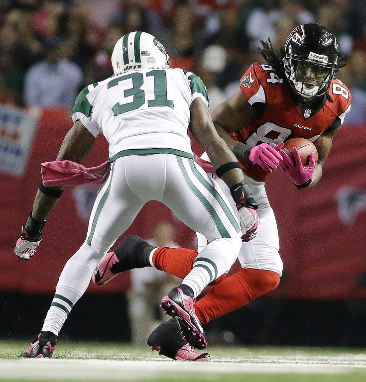 . Atlanta Falcons wide receiver Roddy White (84) runs against New York Jets cornerback Antonio Cromartie (31) during the first half of an NFL football game, Monday, Oct. 7, 2013, in Atlanta. (AP Photo/David Goldman)