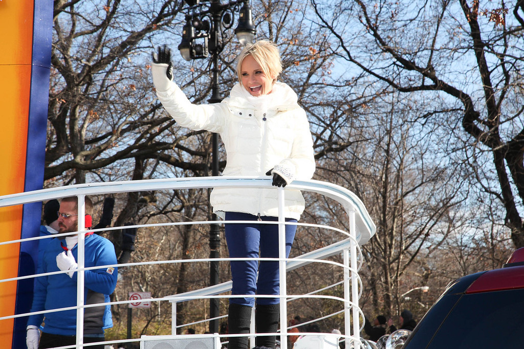 """. Quantum Of The Seas Godmother Kristin Chenoweth sails down the streets of New York onboard Royal Caribbeans new float, \""""A World at Sea,\"""" as part of the 87th Annual Macy\'s Thanksgiving Day Parade festivities on November 28, 2013 in New York City.  (Photo by Rob Kim/Getty Images)"""