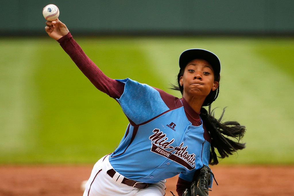 . Pennsylvania\'s Mo\'ne Davis delivers in the first inning against Tennessee during a baseball game in United States pool play at the Little League World Series tournament in South Williamsport, Pa., Friday, Aug. 15, 2014. (AP Photo/Gene J. Puskar)
