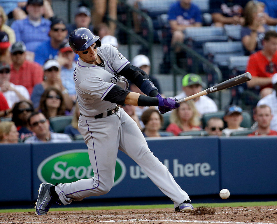 . Colorado Rockies\' Troy Tulowitzki singles in the eighth inning of a baseball game against the Atlanta Braves, Saturday, May 24, 2014, in Atlanta. (AP Photo/David Goldman)