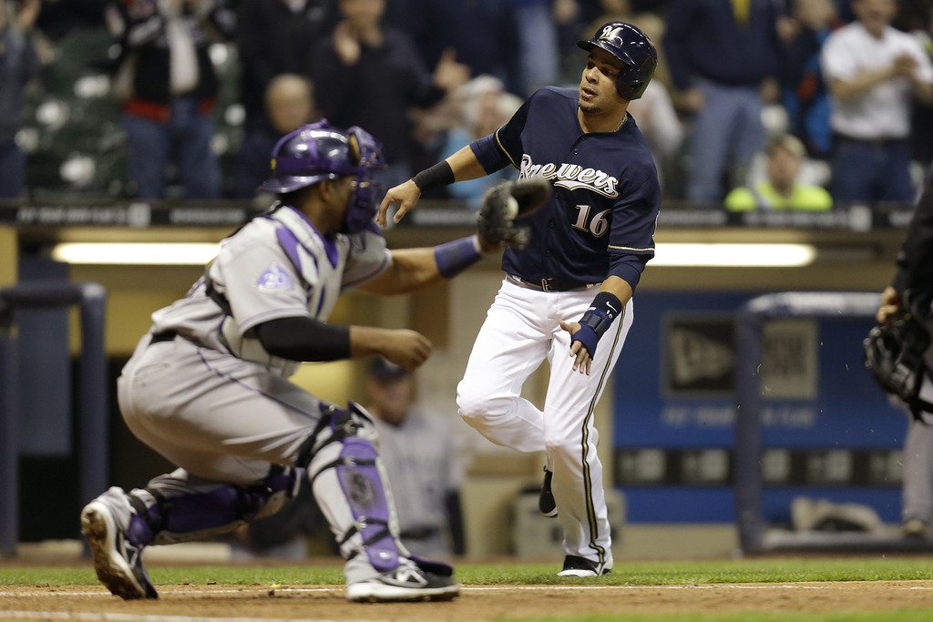 . MILWAUKEE, WI - APRIL 3:  Aramis Ramirez #16 of the Milwaukee Brewers is tagged out at the plate by catcher Wilin Rosario #20 in the bottom of the third inning against the Colorado Rockies at Miller Park on April 3, 2013 in Milwaukee, Wisconsin. (Photo by Mike McGinnis/Getty Images)