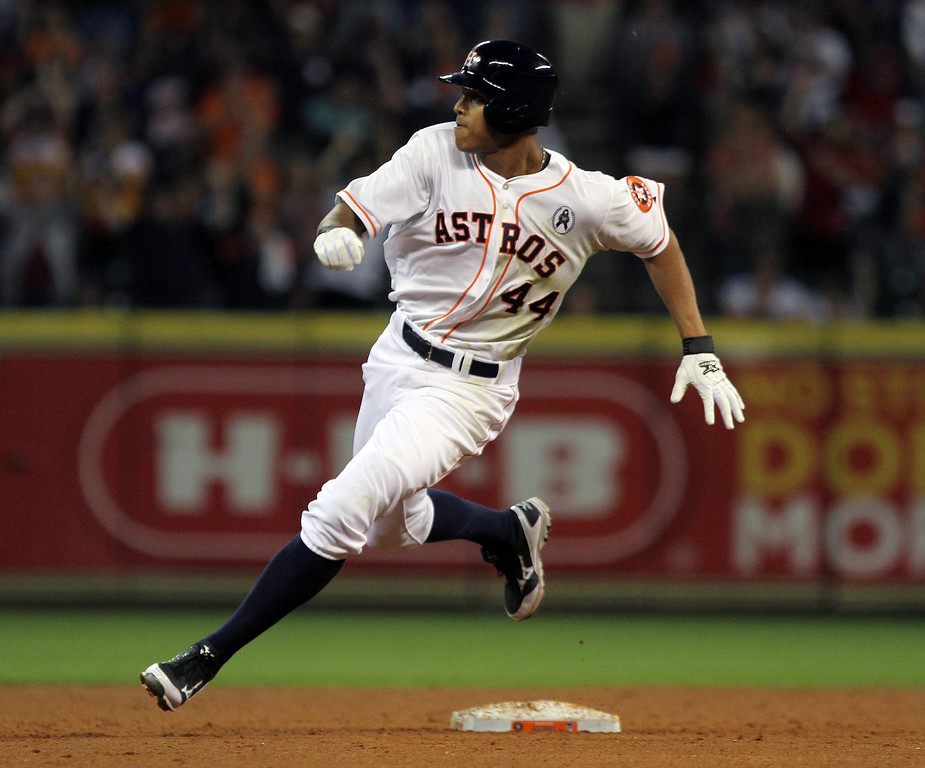 . Houston Astros\' Justin Maxwell (44) rounds second on his two-run triple in the fourth inning of a baseball game against the Texas Rangers on opening day at Minute Maid Park on Sunday, March 31, 2013 in Houston. Houston defeated Texas 8-2. (AP Photo/The Courier, Jason Fochtman)