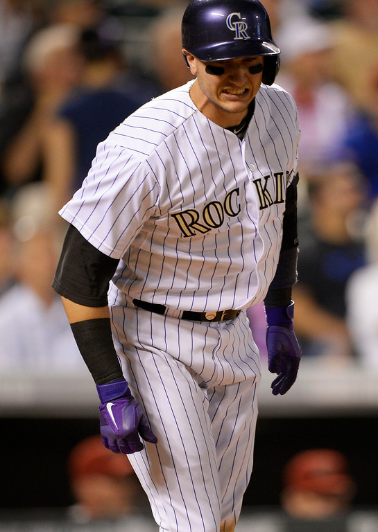 . Colorado Rockies shortstop Troy Tulowitzki (2) reacts after popping up for an out in the 6th inning against the  Arizona Diamondbacks June 3, 2014 at Coors Field. (Photo by John Leyba/The Denver Post)