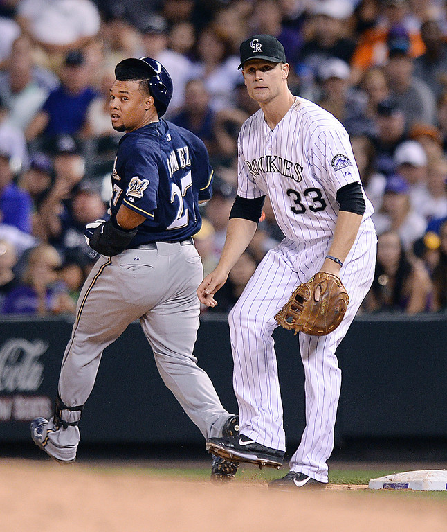 . DENVER, CO - JUNE 20: Milwaukee\'s Carlos Gomez had an infield single to advance Ryan Braun to third base in the sixth inning. The Colorado Rockies hosted the Milwaukee Brewers at Coors Field Friday night, June 20, 2014. Photo by Karl Gehring/The Denver Post