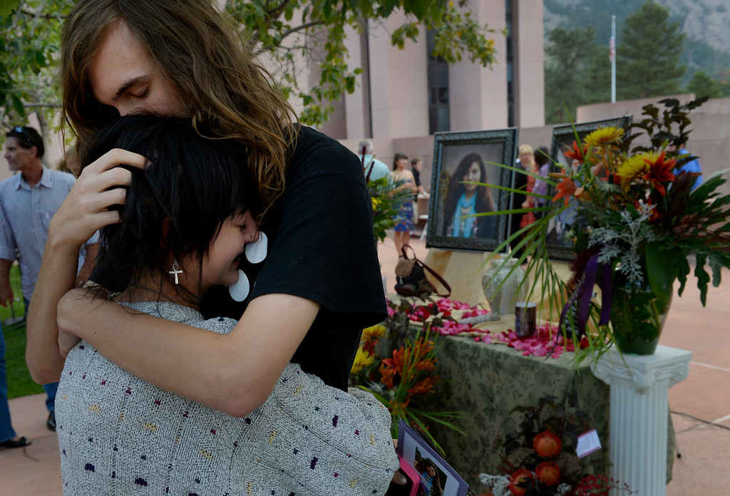 . Sage Ebert and Nick Lutz embrace following a memorial service for their friends Wesley Quinlan and Wiyanna Nelson at the National Center for Atmospheric Research in Boulder, CO September 21, 2013. Over 350 people joined together to honor the couple that died in the recent flood. (Photo By Craig F. Walker / The Denver Post)