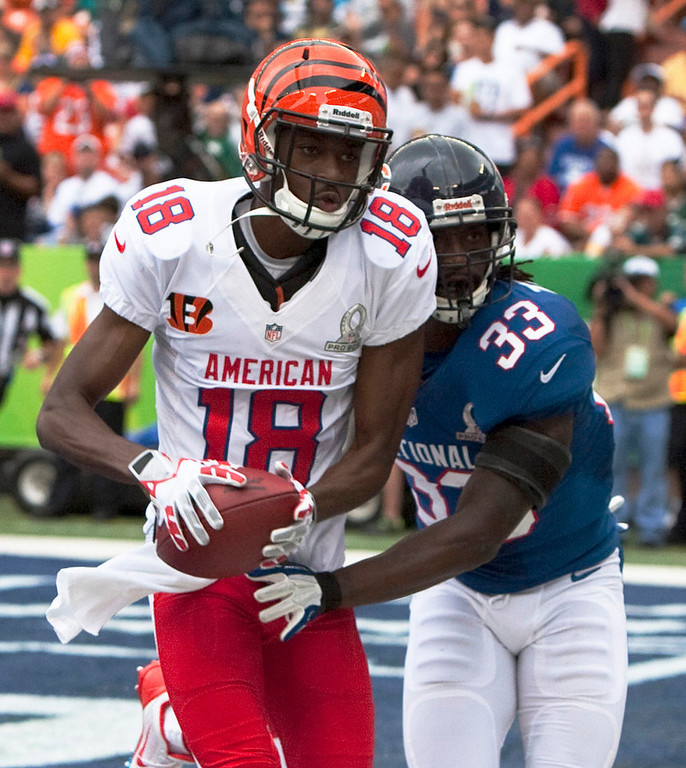 . Cincinnati Bengals wide receiver A.J. Green (18) pulls in a catch over Chicago Bears corner back Charles Tillman (33) of the NFC for a touchdown during the 1st quarter of the NFL Pro Bowl football game in Honolulu, Sunday, Jan. 27, 2013. (AP Photo/Marco Garcia)