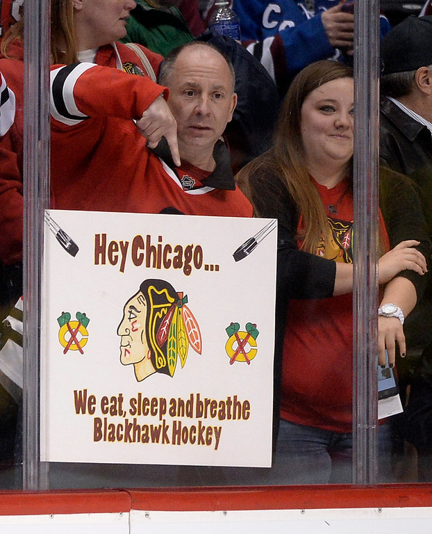 . A Chicago Blackhawks fan tried to get some attention from his favorite team during warmups.  (Photo by Karl Gehring/The Denver Post)