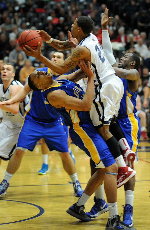 . DENVER, CO. - MARCH 19: Rattlers sophomore guard Joe Monroe (45) held his ground on Metro State\'s Demetrius Miller (25) in the second half. The Metro State men\'s basketball team defeated St. Mary\'s (Texas) 78-70 in a RMAC playoff game Tuesday night, March 19, 2013. With the win the Roadrunners secured the South Central regional championship (Photo By Karl Gehring/The Denver Post)
