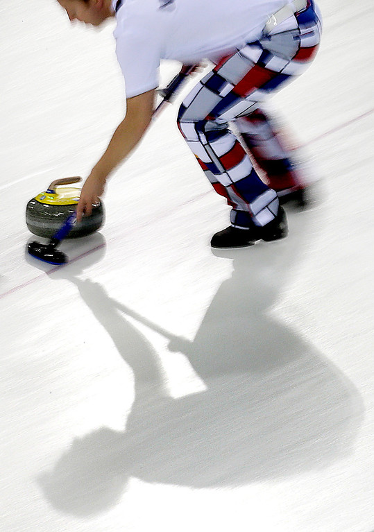 . Norway\'s Torger Nergaard sweeps the ice during the men\'s curling competition against Russia at the 2014 Winter Olympics, Monday, Feb. 10, 2014, in Sochi, Russia. (AP Photo/Wong Maye-E)