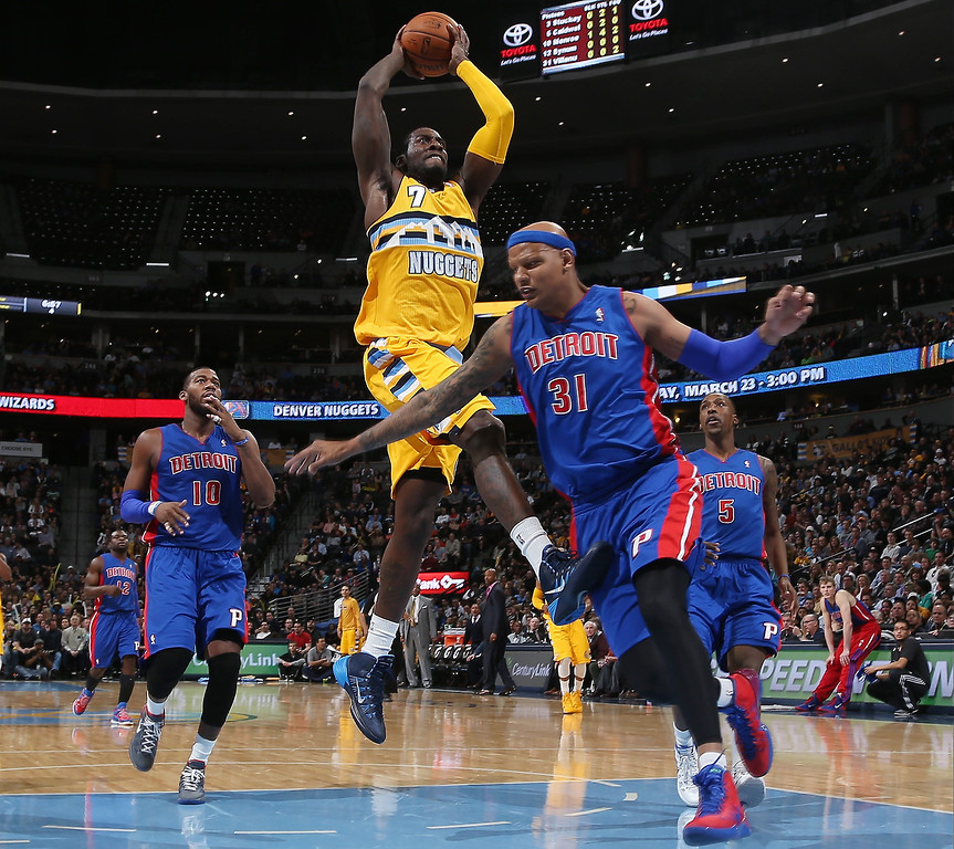 . Denver Nuggets forward J.J. Hickson, center, drives for basket as Detroit Pistons forward Charlie Villanueva, right, and center Greg Monroe cover in the fourth quarter of the Nuggets\' 118-109 victory in an NBA basketball game in Denver on Wednesday, March 19, 2014. (AP Photo/David Zalubowski)