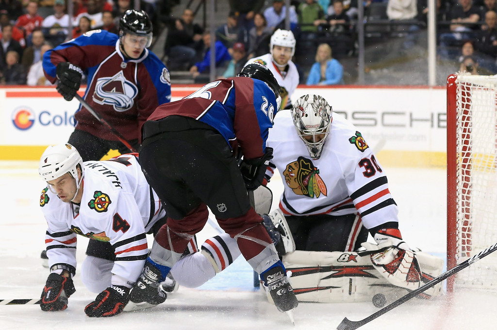 . Goalie Ray Emery #30 of the Chicago Blackhawks stops a shot by Paul Stastny #26 of the Colorado Avalanche at the Pepsi Center on March 18, 2013 in Denver, Colorado.  (Photo by Doug Pensinger/Getty Images)