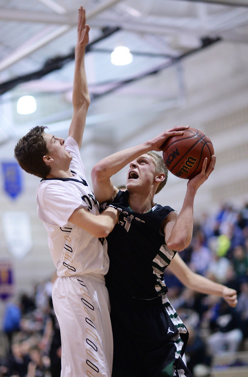 . Alex Semadeni of Fossil Ridge High School (23), right, is scoring against Sam Fredricksmeyer of Monarch High School (5) in the 1st half of the game at Monarch High School Gym. (Photo by Hyoung Chang/The Denver Post)