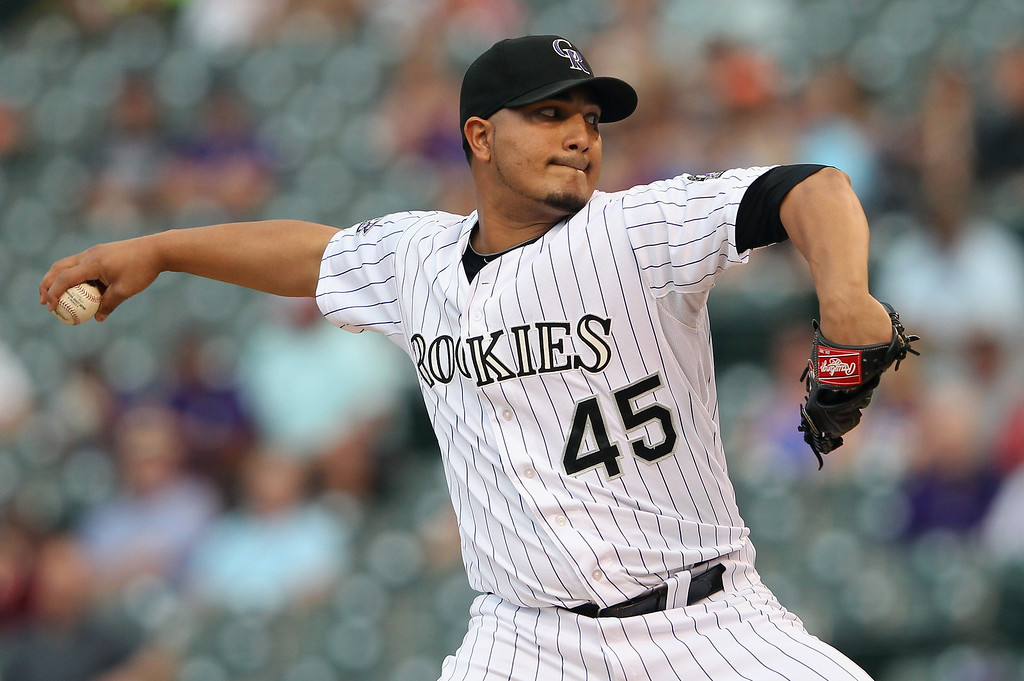 . Starting pitcher Jhoulys Chacin #45 of the Colorado Rockies delivers against the Los Angeles Dodgers at Coors Field on September 3, 2013 in Denver, Colorado.  (Photo by Doug Pensinger/Getty Images)