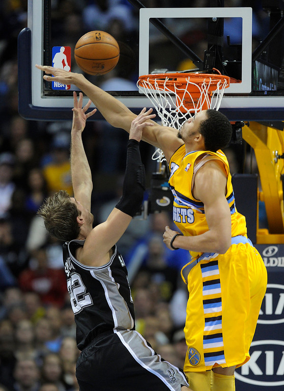 . Denver center JaVale McGee (34) blocked a shot by Spurs forward Tiago Splitter (22) in the second half. The Denver Nuggets defeated the San Antonio Spurs 112-106 at the Pepsi Center Tuesday night, December 18, 2012. Karl Gehring/The Denver Post