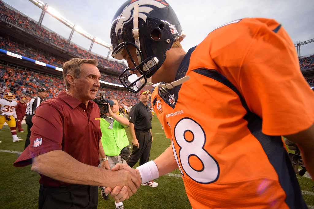 . Denver Broncos quarterback Peyton Manning (18) shakes hands with Washington Redskins head coach Mike Shanahan after the game.  (Photo by John Leyba/The Denver Post)