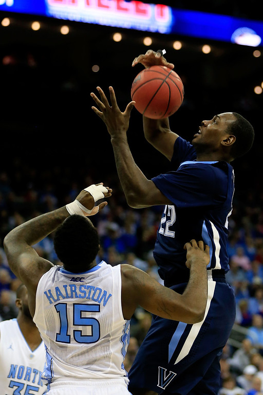 . KANSAS CITY, MO - MARCH 22: JayVaughn Pinkston #22 of the Villanova Wildcats shoots against P.J. Hairston #15 of the North Carolina Tar Heels in the second half during the second round of the 2013 NCAA Men\'s Basketball Tournament at the Sprint Center on March 22, 2013 in Kansas City, Missouri.  (Photo by Jamie Squire/Getty Images)