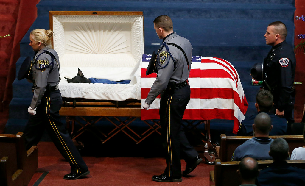 . Police officers file past the casket of Oklahoma City police canine officer K-9 Kye during funeral services in Oklahoma City, Thursday, Aug. 28, 2014.  (AP Photo/Sue Ogrocki)