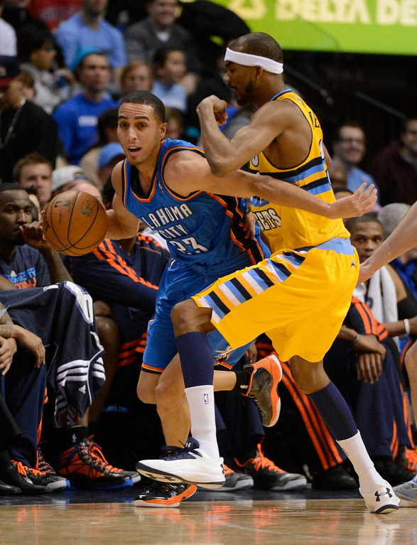 . DENVER, CO. - JANUARY 20: Oklahoma City Thunder shooting guard Kevin Martin (23) works his way around the defense of Denver Nuggets small forward Corey Brewer (13) during the second quarter January 20,  2013 at Pepsi Center. (Photo By John Leyba / The Denver Post)