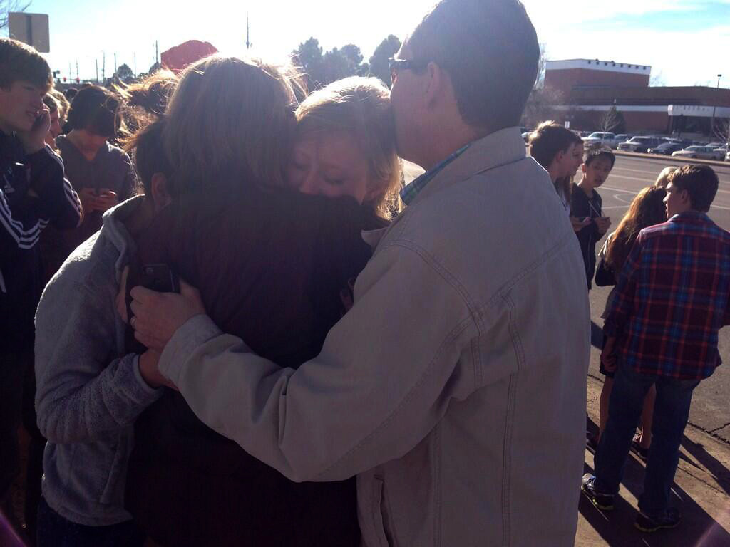. Students and family members gathered outside Arapahoe High School in Centennial, Colo. after reports of shots fired inside the school on Friday afternoon, Dec. 13, 2013. (Photo by Ryan Parker/The Denver Post)