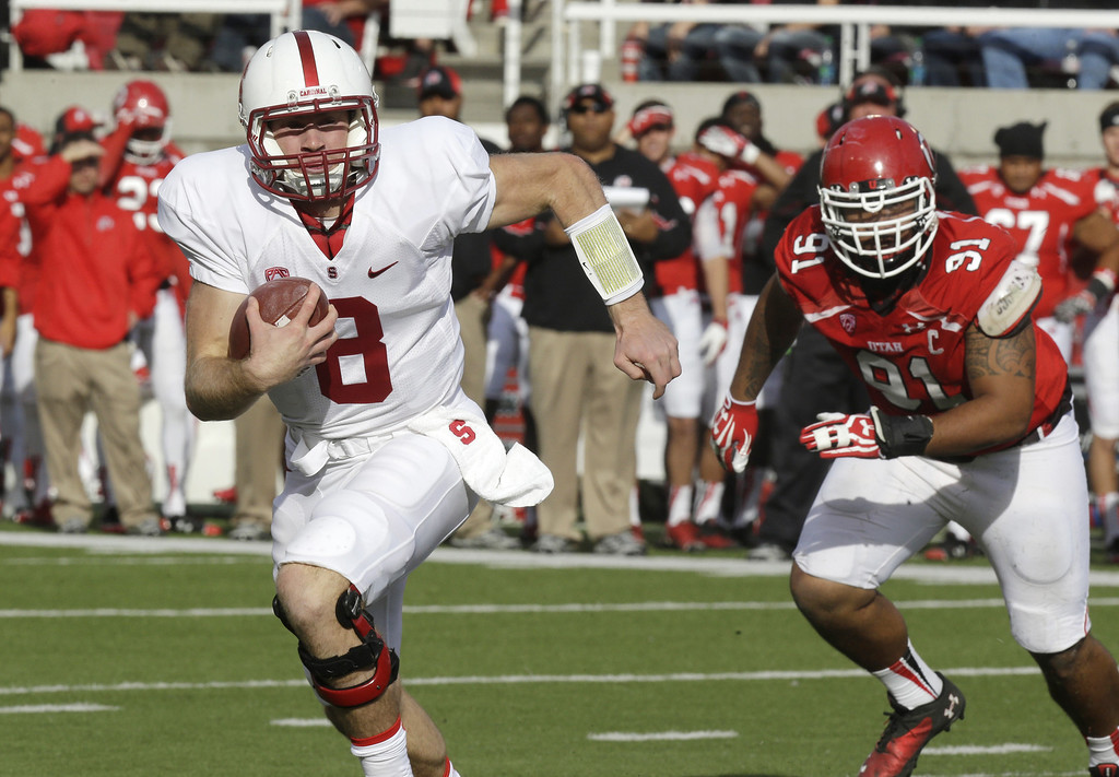 . Stanford quarterback Kevin Hogan (8) carries the ball as Utah defensive tackle Tenny Palepoi (91) pursues during the first quarter of an NCAA college football game on Saturday, Oct. 12, 2013, in Salt Lake City. (AP Photo/Rick Bowmer)