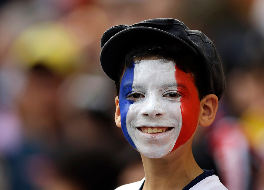 . A French supporter shows off his face paint with the national colors before the World Cup round of 16 soccer match between France and Nigeria at the Estadio Nacional in Brasilia, Brazil, Monday, June 30, 2014. (AP Photo/Andrew Medichini)