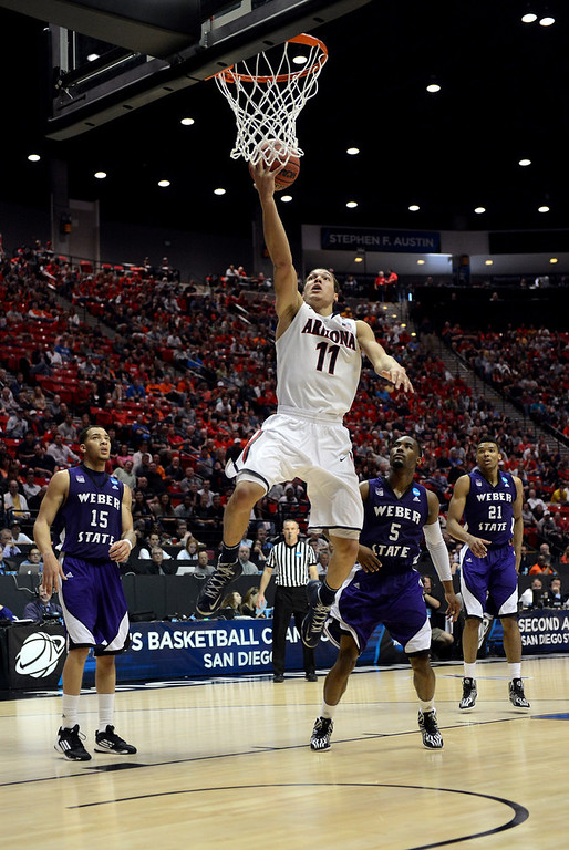 . Aaron Gordon #11 of the Arizona Wildcats goes up for a lay up against the Weber State Wildcats during the second round of the 2014 NCAA Men\'s Basketball Tournament at Viejas Arena on March 21, 2014 in San Diego, California.  (Photo by Donald Miralle/Getty Images)