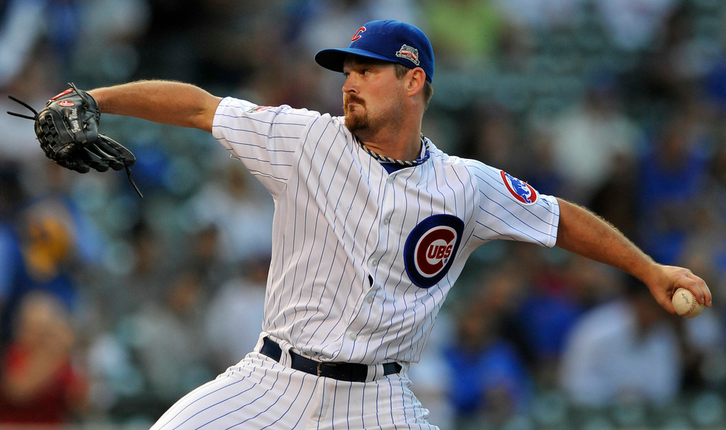 . Chicago Cubs starter Travis Wood delivers a pitch during the first inning of a baseball game agains the Colorado Rockies in Chicago, Wednesday, July 30, 2014. (AP Photo/Paul Beaty)