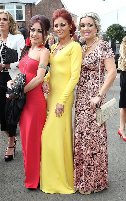 . Racegoers enjoy Ladies Day at Aintree on April 5, 2013 in Liverpool, England. Friday is traditionally Ladies day at the three-day meeting of the world famous Grand National, where fashion and dressing to impress is as important as the racing. (Photo by Danny E. Martindale/Getty Images)
