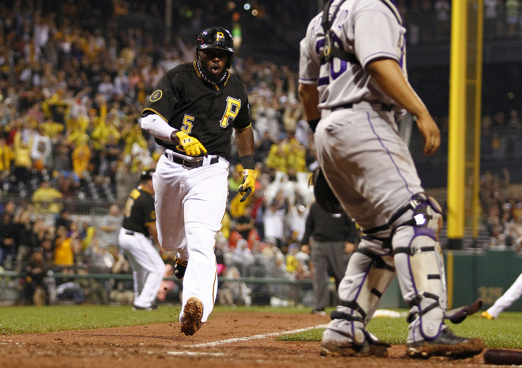 . PITTSBURGH, PA - JULY 19: Josh Harrison #5 of the Pittsburgh Pirates celebrates while scoring on a RBI single in the eighth inning against the Colorado Rockies during the game at PNC Park July 19, 2014 in Pittsburgh, Pennsylvania. (Photo by Justin K. Aller/Getty Images)