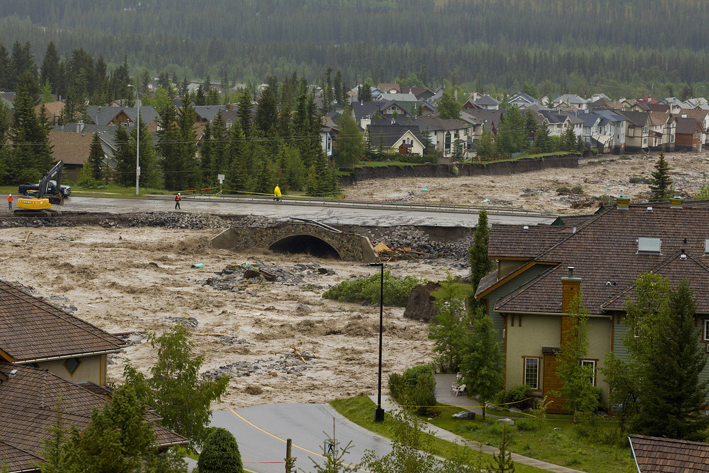 . CANMORE, CANADA - JUNE 20:  Cougar Creek takes out Eagle Terrace Road and breaches Elk Run Blvd Bridge June 20, 2013 in Canmore, Alberta, Canada. Widespread flooding caused by torrential rains washed out bridges and roads prompting the evacuation of thousnds.  (Photo by John Gibson/Getty Images)