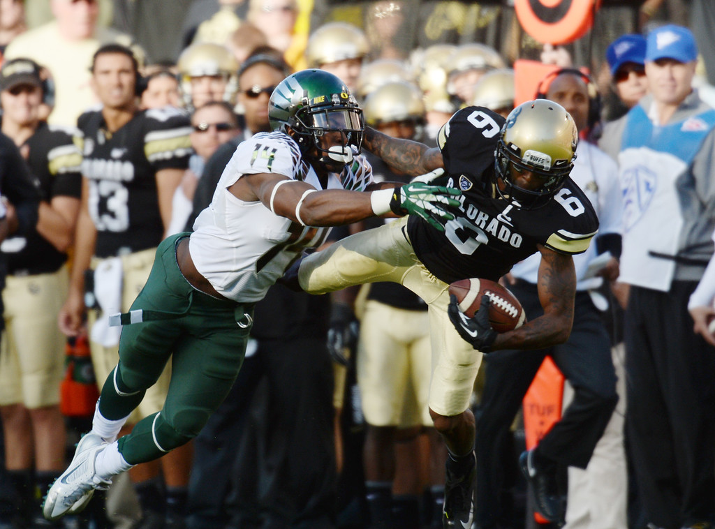 . WR Paul Richardson of University of Colorado (6) trys to bring in a pass from QB Connor Wood (5) against DB Ifo Ekpre-Olomu of University of Oregon (14) in the 1st quarter of the game at Folsom Field. Boulder, Colorado. October 5, 2013. The pass was incomplete. (Photo by Hyoung Chang/The Denver Post)