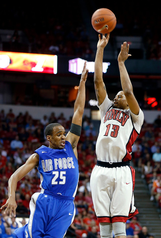 . UNLV\'s Bryce Dejean-Jones shoots over Air Force\'s Kyle Green during the second half of a Mountain West Conference tournament NCAA college basketball game, Wednesday, March 13, 2013, in Las Vegas. UNLV defeated Air Force 72-56. (AP Photo/Isaac Brekken)