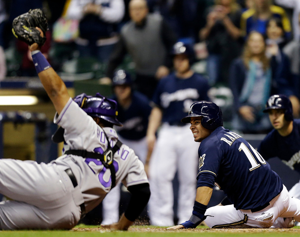 . Milwaukee Brewers\' Aramis Ramirez(16) reacts after being tagged out by Colorado Rockies catcher Wilin Rosario, left, at home plate during the third inning of a baseball game, Wednesday, April 3, 2013, in Milwaukee. (AP Photo/Jeffrey Phelps)
