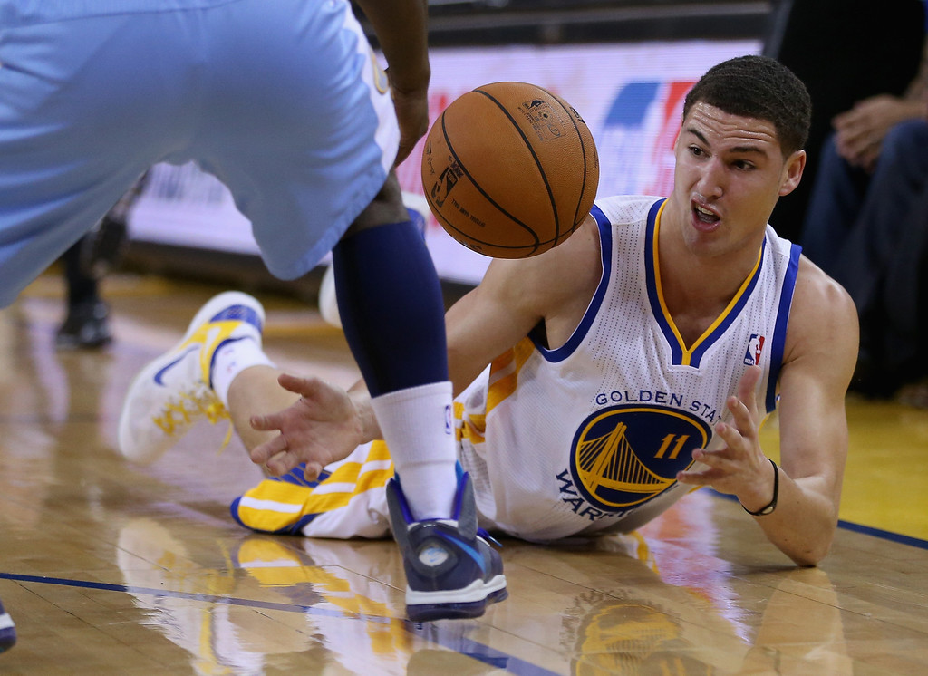 . OAKLAND, CA - NOVEMBER 29: Klay Thompson #11 of the Golden State Warriors scrambles for a loose ball during their game against the Denver Nuggets at Oracle Arena on November 29, 2012 in Oakland, California.  (Photo by Ezra Shaw/Getty Images)