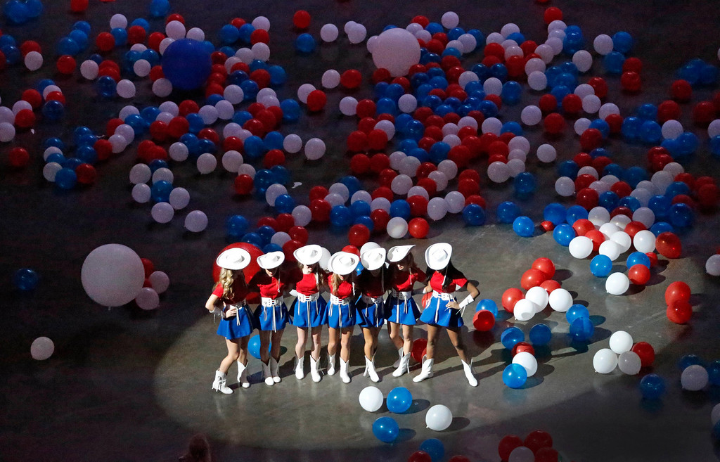 . A group of Kilgore Rangerettes gets a group photo taken after a balloon drop concludes a video presentation during the Republican National Committee site selection committee visit to the American Airlines Center, as the city of Dallas vies for the 2016 Republican National Convention, on Thursday, June 12, 2014.  (Louis DeLuca/Dallas Morning News)