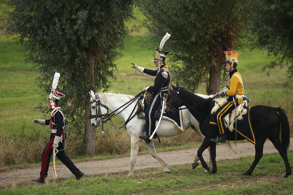. Historical society enthusiasts in the role of Polish lancers led by Polish Prince and Marshall Jozef Poniatowski (C) and fighting under Napoleon arrive to re-enact The Battle of Nations on its 200th anniversary on October 20, 2013 near Leipzig, Germany.  (Photo by Sean Gallup/Getty Images)