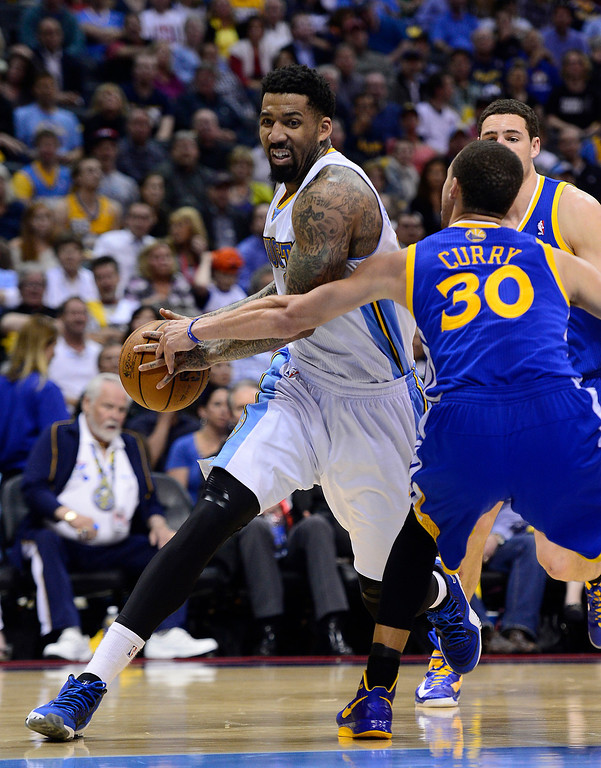 . Denver Nuggets shooting guard Wilson Chandler (21) drives around Golden State Warriors point guard Stephen Curry (30) in the third quarter. The Denver Nuggets took on the Golden State Warriors in Game 5 of the Western Conference First Round Series at the Pepsi Center in Denver, Colo. on April 30, 2013. (Photo by AAron Ontiveroz/The Denver Post)