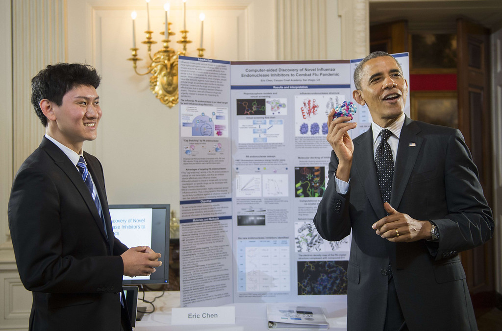 . US President Barack Obama (R) holds up a 3-D model of the influenza virus as he talks with Eric Chen, of San Diego, California, during the White House Science Fair at the White House in Washington, DC, May 27, 2014.The White House Science Fair celebrates the student winners of a broad range of science, technology, engineering and math (STEM) competitions from across the country.       AFP PHOTO / Jim  WATSON/AFP/Getty Images