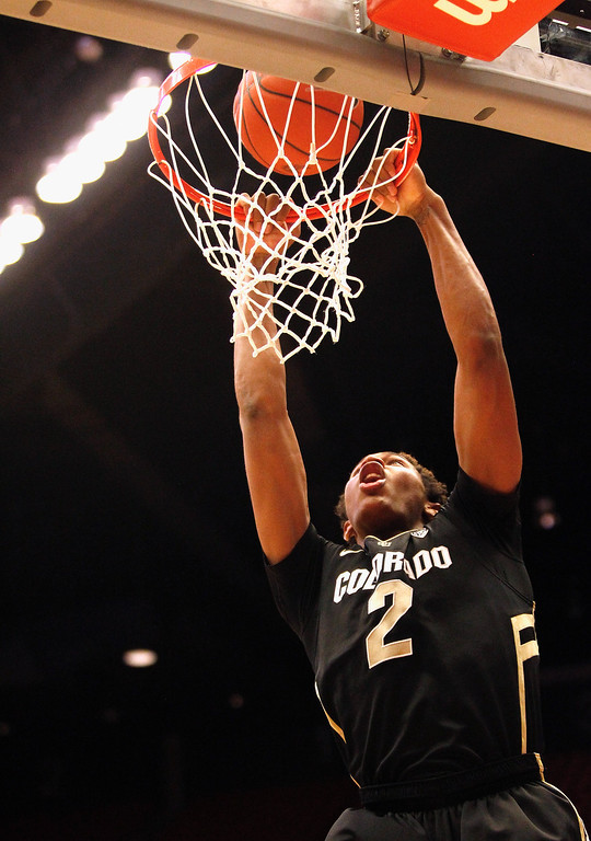 . PULLMAN, WA - JANUARY 19:  Forward Xavier Johnson #2 of the Colorado Buffaloes goes up for a dunk shot during the second half of the game against the Washington State Cougars at Beasley Coliseum on January 19, 2013 in Pullman, Washington.  (Photo by William Mancebo/Getty Images)