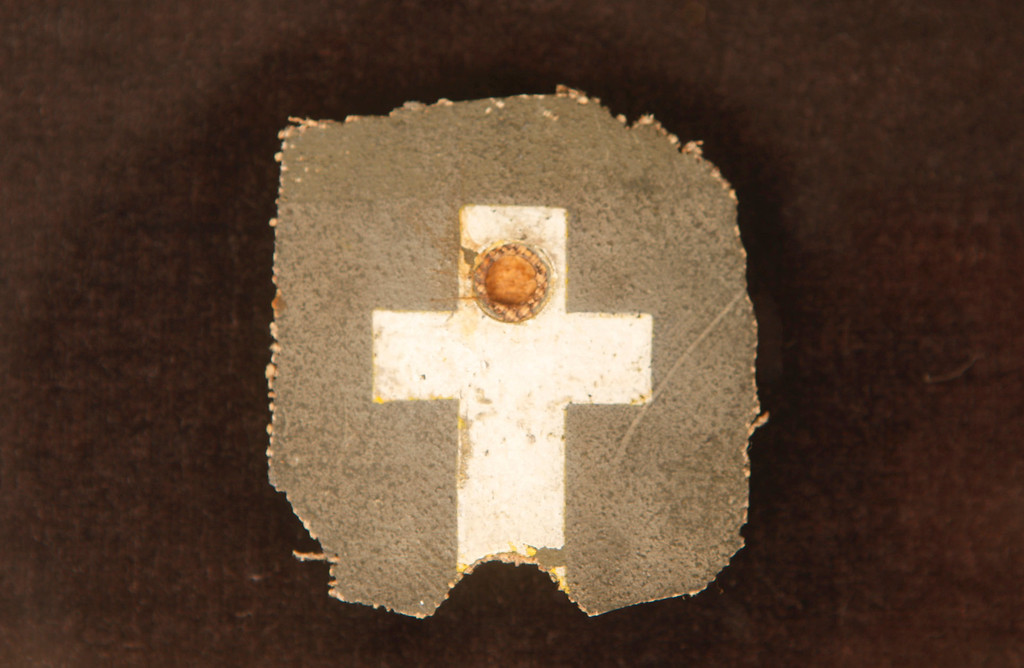. This is a painted cross from Fr. Kapaun\'s helmet liner. The helmet was taken from the camp after Fr. Kapaun\'s death and tossed in the dump. Marine Corp Warrant Officer Felix J. McCool retrieved the cross from the broken liner and returned it to the Wichita Diocese. (Bo Rader/Wichita Eagle/MCT)