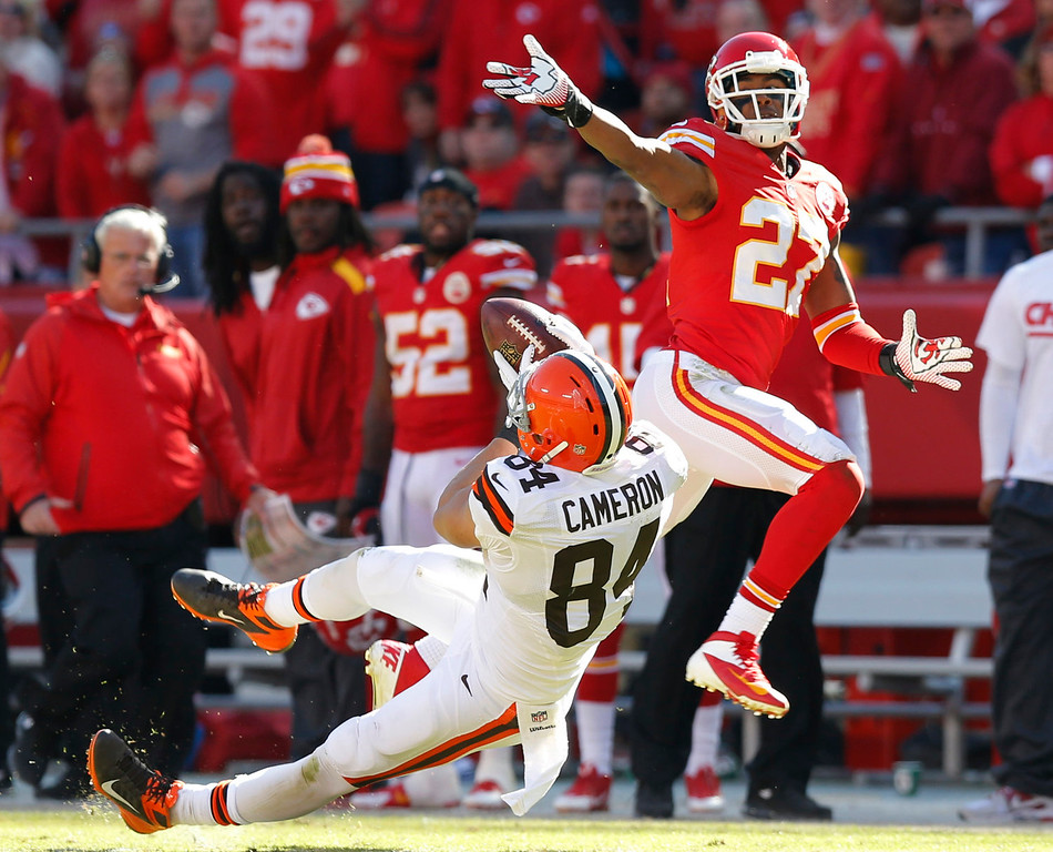 . Cleveland Browns tight end Jordan Cameron (84) catches the ball while covered by Kansas City Chiefs cornerback Sean Smith (27) during the second half of an NFL football game in Kansas City, Mo., Sunday, Oct. 27, 2013. (AP Photo/Ed Zurga)