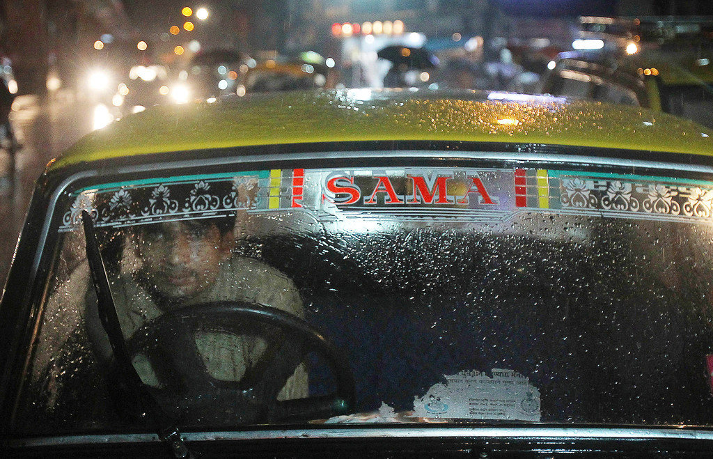 . In this Aug. 1, 2013 photo, a Taxi driver of  Premier Padmini taxi waits for passengers in Mumbai, India. More than 400 Premier Padmini taxis are expected to stop running in Mumbai in August in line with a Maharashtra government order that bans cabs that are more than 20 years old from plying in the city from Aug. 1. (AP Photo/Rafiq Maqbool)