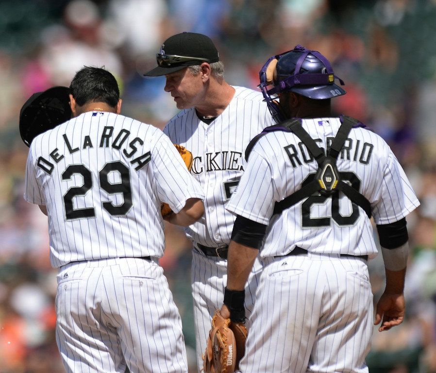 . DENVER, CO - JULY 5:  Colorado pitching coach Jim Wright shared his thoughts with starter Jorge De La Rosa in the fifth inning. De La Rosa had just given up two straight walks. The Colorado Rockies defeated the Los Angeles Dodgers 8-7 at Coors Field Saturday afternoon, July 5, 2014.  Photo by Karl Gehring/The Denver Post