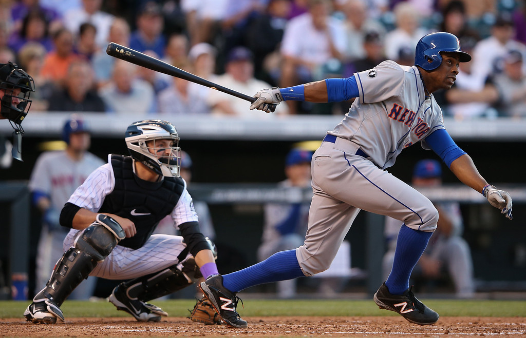 . DENVER, CO - MAY 03:  Curtis Granderson #3 of the New York Mets hits an RBI single to score David Wright #5 of the New York Mets and give the Mets a 4-0 lead over the Colorado Rockies in the third inning at Coors Field on May 3, 2014 in Denver, Colorado.  (Photo by Doug Pensinger/Getty Images)