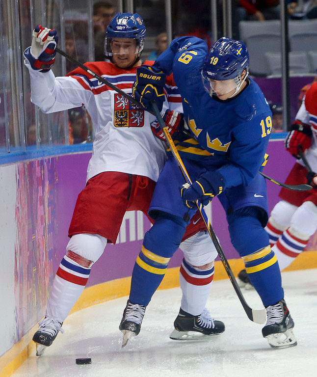 . Czech Republic forward Roman Cervenka fights for control of the puck against Sweden forward Nicklas Backstrom in the first period of a men\'s ice hockey game at the 2014 Winter Olympics, Wednesday, Feb. 12, 2014, in Sochi, Russia. (AP Photo/Mark Humphrey)