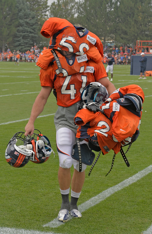 . Denver Broncos S Ross Rasner (41) had the duty of carrying in the veterans equipment after practice during training camp July 29, 2013 at Dove Valley. (Photo By John Leyba/The Denver Post)