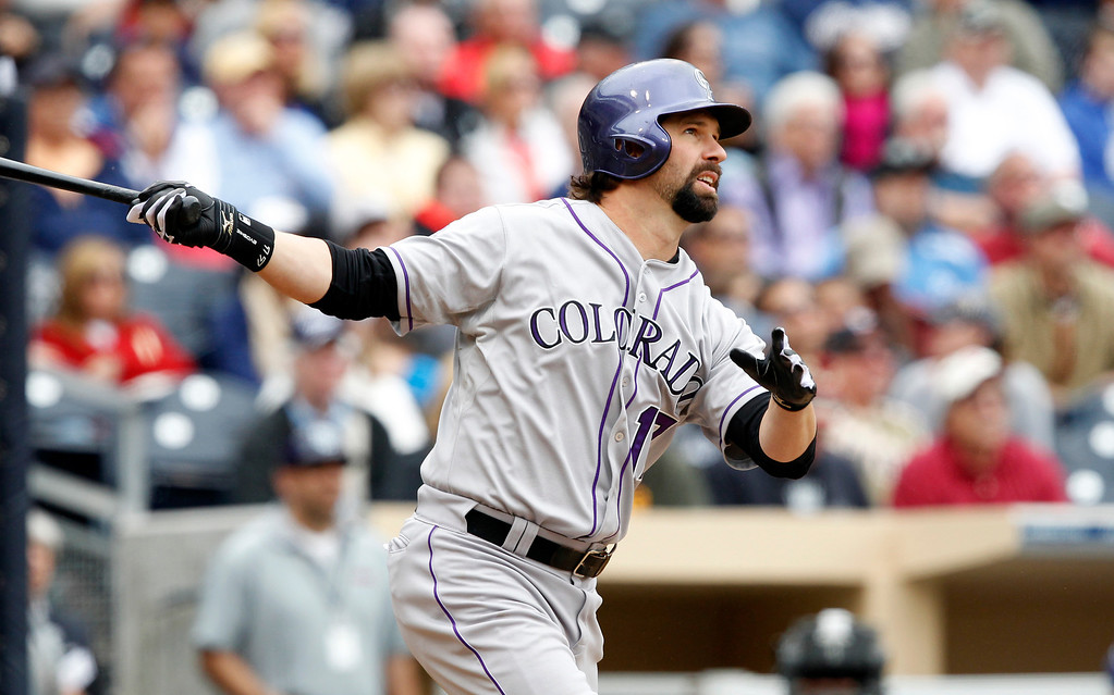 . Colorado Rockies\' Todd Helton hits a pinch-hit, two-run home run against the San Diego Padres in the seventh inning of a baseball game Sunday, April 14, 2013, in San Diego. (AP Photo/Alex Gallardo)