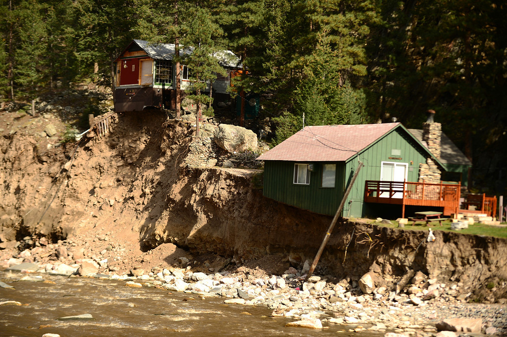 . Some homes are completely inaccessible along Highway 34  near Drake, Co on October 16, 2013. (Photo By Helen H. Richardson/ The Denver Post)